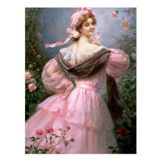 Elegant woman in a rose garden postcard