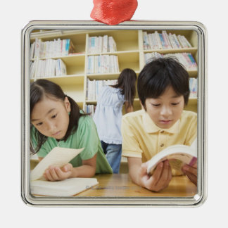 Elementary school students reading a book Silver-Colored square decoration