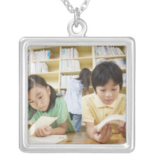 Elementary school students reading a book silver plated necklace