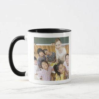 Elementary students and teacher mug
