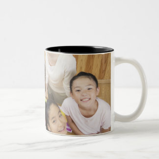 Elementary students and teacher Two-Tone coffee mug