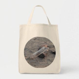 Elephant Seal Under Log on Beach Canvas Bag