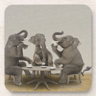 Elephants having tea party beverage coaster