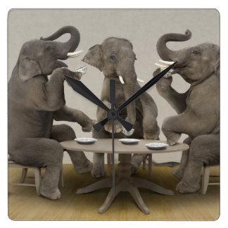 Elephants having tea party clocks