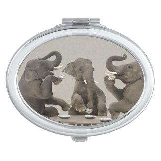 Elephants having tea party compact mirror