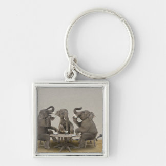 Elephants having tea party key ring
