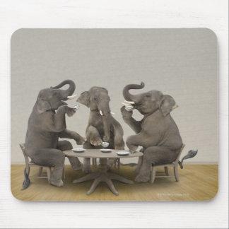 Elephants having tea party mouse pad
