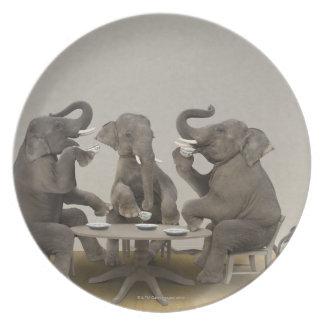 Elephants having tea party party plates