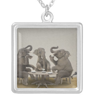 Elephants having tea party silver plated necklace