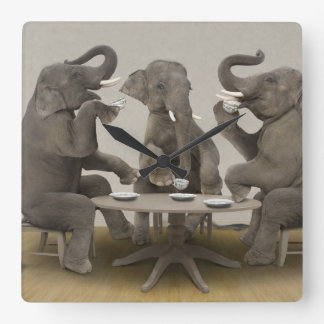 Elephants having tea party square wall clock