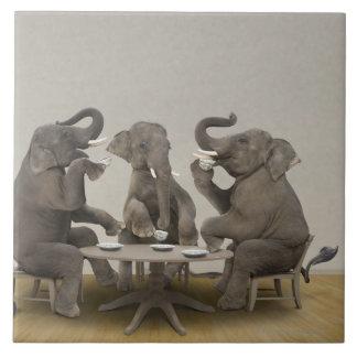 Elephants having tea party tile