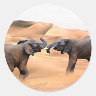 Elephants in the desert round sticker