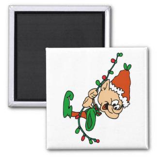 elf swinging on lights magnet