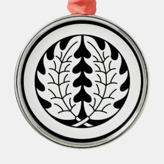 Embracing holly leaves in circle christmas ornament