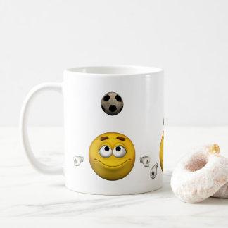 Emoticon plays football, cartoon style coffee mug