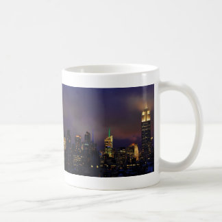 Empire State Building glows in clouds and fog Basic White Mug
