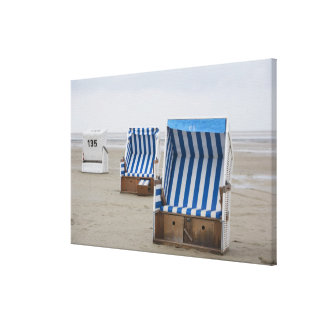 empty beach chairs on beach canvas print