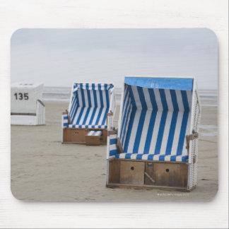 empty beach chairs on beach mouse mat