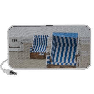 empty beach chairs on beach mp3 speakers