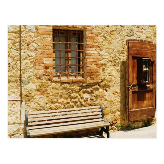 Empty bench in front of a wall, Monteriggioni, Postcard