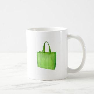 Empty green reusable grocery bag mug