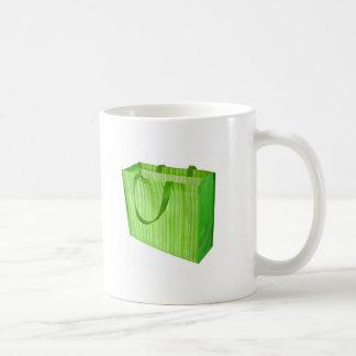Empty green reusable shopping bag coffee mug