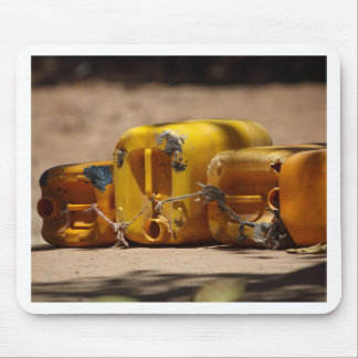 Empty water cans at a well in Africa. Mouse Pad