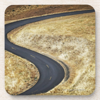 Empty winding paved road beverage coasters