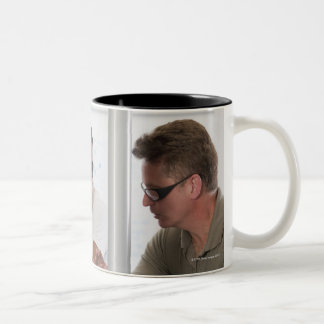 Engineering professor demonstrating a coordinate Two-Tone coffee mug