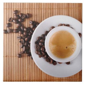 Espresso cup on a mat tile
