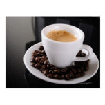 Espresso cup on black granite counter