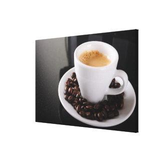 Espresso cup on black granite counter canvas print
