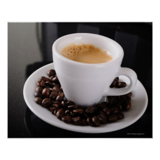 Espresso cup on black granite counter poster