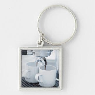 Espresso machine making coffee key ring