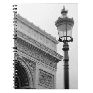 Europe, France, Paris. Arc de Triomphe and Notebooks