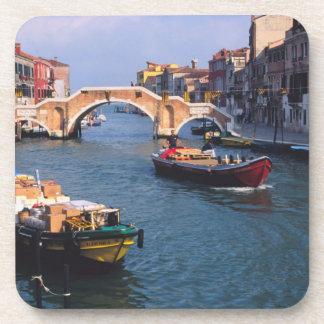 Europe, Italy, Venice. Boats bringing in Coaster