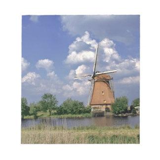 Europe, Netherlands, Kinerdijk. A windmill sits Notepad