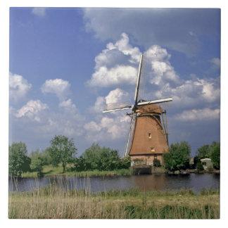 Europe, Netherlands, Kinerdijk. A windmill sits Tile