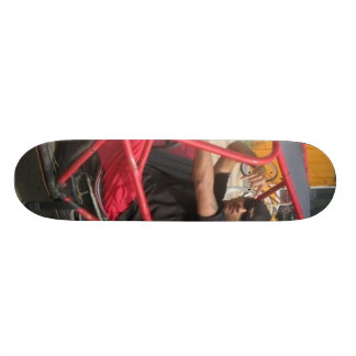 Evan in a rollover car red skate board deck
