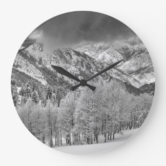 Evergreens and Aspen trees in a snow storm Large Clock