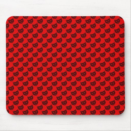 evil smiley faced black hearts on rough red surfac mouse pads