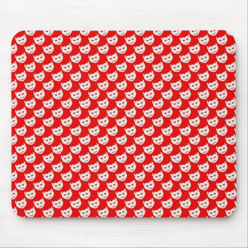 evil smiley faced white hearts on rough red surfac mouse pads
