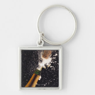 Exploding champagne bottle Silver-Colored square key ring