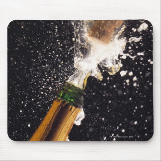 Exploding champagne bottle mouse mat