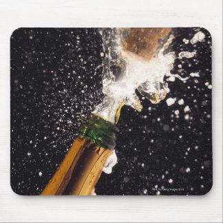 Exploding champagne bottle mouse mat