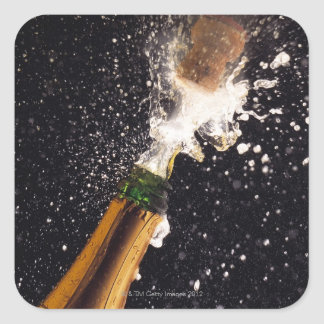 Exploding champagne bottle square sticker