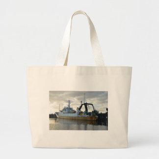 Exploration ship at dawn. large tote bag