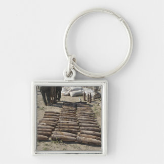 Explosive devices are identified and inventorie Silver-Colored square key ring