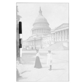Exterior of the Capitol building with women Dry Erase Board