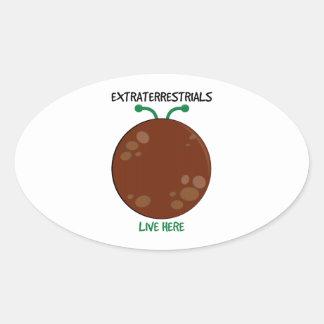 Extraterrestrials Live Here Oval Sticker